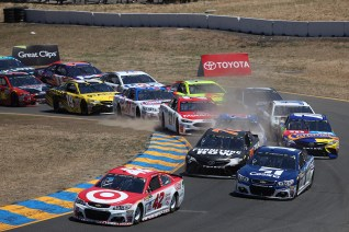 Monster Energy NASCAR Cup Series driver Kyle Larson (42) leads the first lap at the Toyota/Save Mart 350 at Sonoma Raceway in Sonoma, Calif., on Sunday, June 24, 2017.
