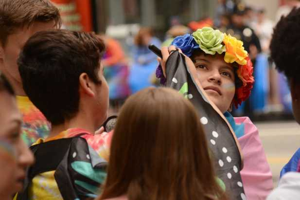A youth gets makeup done before the Pride Celebration in San Francisco, Calif., on Sunday, June 25, 2017.