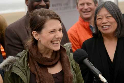 Shelly Ericksen (left), 41, volunteer lead for a cigarette-cleanup program at the Surfrider Foundation from San Francisco, smiles as she speaks about clearing cigarettes from the streets while SF Supervisor Sandra Lee Fewer (right) smiles and looks on at Ocean Beach in San Francisco, Calif., on Friday, June 30, 2017. SF Supervisors Katy Tang and Fewer helped launch a pilot program to encourage people to throw their cigarettes away in receptacles instead of throwing them away on the streets.