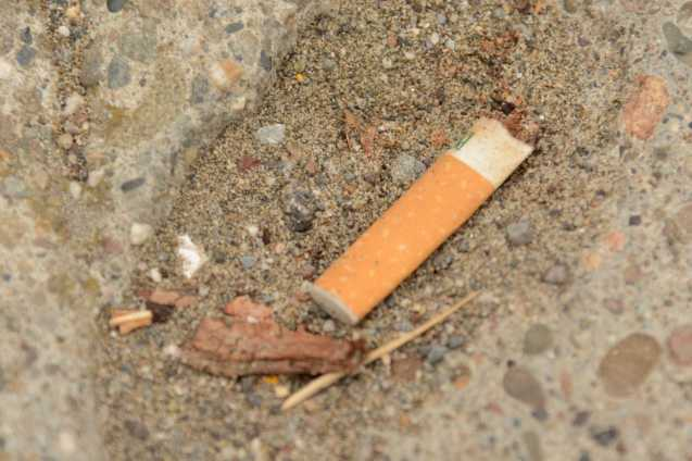 A discarded cigarette butt litters the street by Ocean Beach in San Francisco, Calif., on Friday, June 30, 2017. SF Supervisors Katy Tang and Sandra Lee Fewer helped launch a pilot program to encourage people to throw their cigarettes away in receptacles instead of throwing them away on the streets.