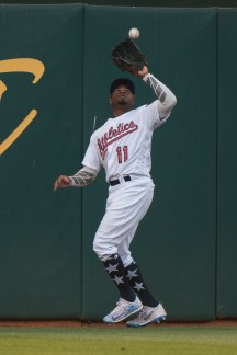 Oakland Athletics center fielder Rajai Davis (11) catches a fly ball in the sixth inning of the game against the Chicago White Sox at the Oakland Coliseum in Oakland, Calif., on July 3, 2017.