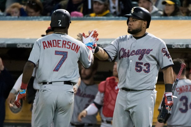 Chicago White Sox shortstop Tim Anderson (7) is congratulated by left fielder Melky Cabrera (53) after scoring in the eighth inning of the game against the Oakland Athletics at the Oakland Coliseum in Oakland, Calif., on July 3, 2017.