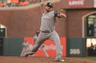 Miami Marlins pitcher Dan Straily (58) throws a pitch in the first inning as the Miami Marlins face the San Francisco Giants at AT&T Park on Friday, July 7, 2017.