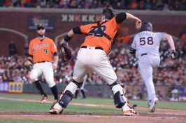San Francisco Giants catcher Buster Posey (28) picks up Miami Marlins pitcher Dan Straily's (58) bunt to start a double play in the eighth inning as the Miami Marlins face the San Francisco Giants at AT&T Park on Friday, July 7, 2017.