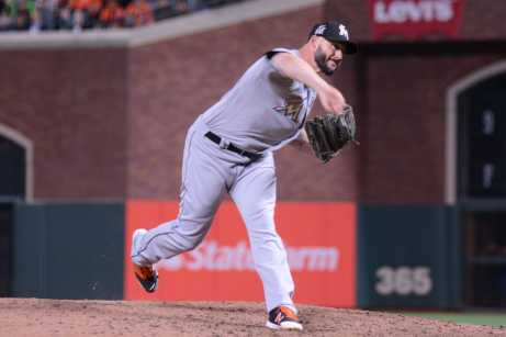 Miami Marlins pitcher Dustin McGowan (22) throws a pitch in the ninth inning as the Miami Marlins face the San Francisco Giants at AT&T Park on Friday, July 7, 2017.