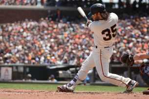 San Francisco Giants second baseman Brandon Belt (9) doubles to right field in the second inning as the Miami Marlins face the San Francisco Giants at AT&T Park on Friday, July 9, 2017.