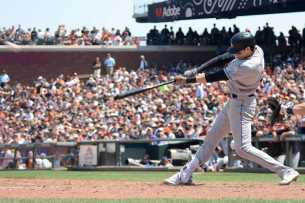 Miami Marlins center fielder Christian Yelich (21) hits a double in the seventh inning as the Miami Marlins face the San Francisco Giants at AT&T Park on Friday, July 9, 2017.