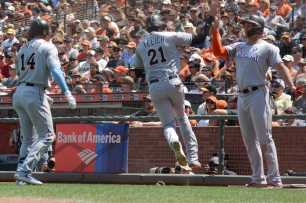 Miami Marlins center fielder Christian Yelich (21) gives a leaping high-five after scoring in the seventh inning a the Marlins face the San Francisco Giants at AT&T Park on Friday, July 9, 2017.