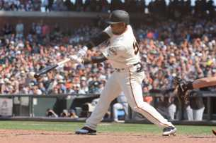 San Francisco Giants infielder Miguel Gomez (52) hits a single to tie the game as the Miami Marlins face the San Francisco Giants at AT&T Park on Friday, July 9, 2017.