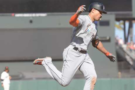 Miami Marlins right fielder Giancarlo Stanton (27) spreads his arms as he jogs to home plate after hitting a home run in the eleventh inning as the Miami Marlins face the San Francisco Giants at AT&T Park on Friday, July 9, 2017.