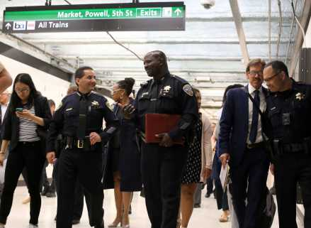 Carlos Rojas, BART chief of police and Mikail Ali, deputy chief of the San Francisco Police Department, chat during a tour of the BART Powell Station in San Francisco, Calif., on Thursday, July 13, 2017.