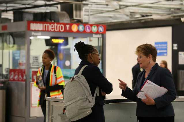BART board member Lateefah Simon, middle, and Grace Crunican, right, general manager of BART, speak during a tour of the BART Powell Station in San Francisco, Calif., on Thursday, July 13, 2017.