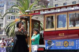 Amanda King, jazz singer, seranades to the song 'Jingle Bells' during the amateur competition at the 54th Cable Car Bell Ringing Contest at Union Square in San Francisco, Calif., on Thursday, July 13, 2017.