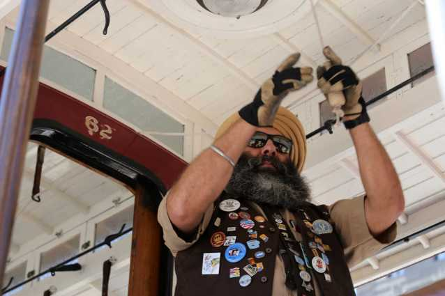 Singh Balraj Rai, cable car gripman for Muni for the past 16 years, performs at the 54th cable car bell ringing contest at Union Square in San Francisco, Calif., on Thursday, July 13, 2017.