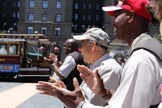 Byron Cobb, right, a 35-year Muni veteran, applauds and cheers past cable car bell ringing champions at Union Square in San Francisco, Calif., on , Thursday,July 13, 2017.