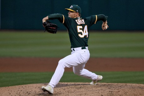 Oakland Athletics starting pitcher Sonny Gray (54) throws a pitch in the fourth inning as the Cleveland Indians face the Oakland Athletics at Oakland Coliseum in Oakland, Calif., on Friday, July 14, 2017.