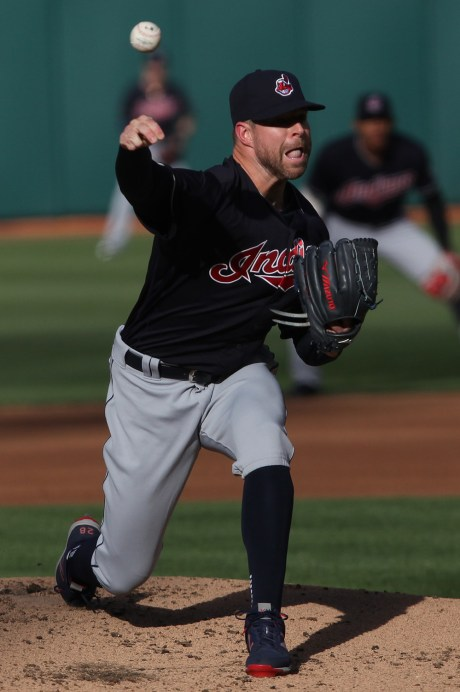 Cleveland Indians starting pitcher Corey Kluber (28) throws a pitch in the first inning as the Cleveland Indians face the Oakland Athletics at Oakland Coliseum in Oakland, Calif., on Saturday, July 15, 2017.