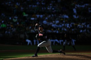 Cleveland Indians starting pitcher Corey Kluber (28) throws a pitch in the second inning as the Cleveland Indians face the Oakland Athletics at Oakland Coliseum in Oakland, Calif., on Saturday, July 15, 2017.