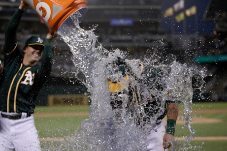 Oakland Athletics third baseman Matt Chapman (26) gets doused after hitting two home runs in the victory over the Cleveland Indians at Oakland Coliseum in Oakland, Calif., on Saturday, July 15, 2017.