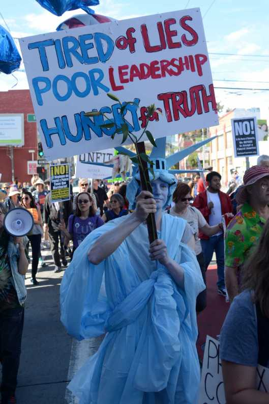 Daniel Johnson, 48, an archivist for a video production company from San Francisco, marches in Statue of Liberty regalia at an anti-Trump protest in San Francisco, Calif., on Saturday, July 15, 2017.