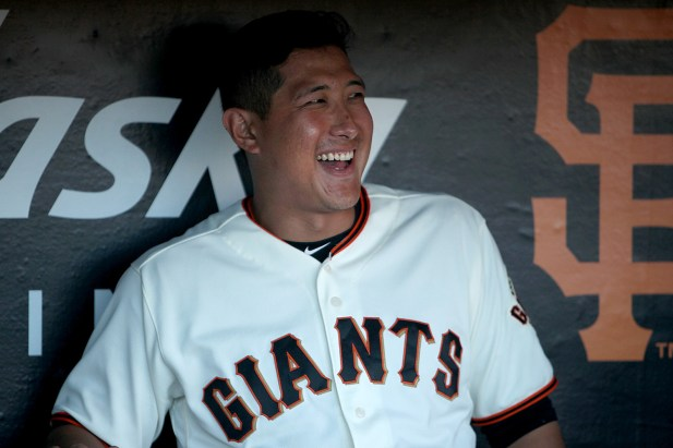 San Francisco Giants infielder Jae-Gyun Hwang (1) sits in the dugout before the Cleveland Indians face the San Francisco Giants at AT&T Park in San Francisco, Calif., on Monday, July 17, 2017.