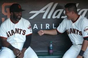 San Francisco Giants infielder Jae-Gyun Hwang (1) and center fielder Denard Span (2) talk in the dugout before the Cleveland Indians face the San Francisco Giants at AT&T Park in San Francisco, Calif., on Monday, July 17, 2017.