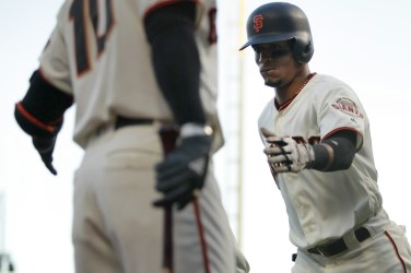 San Francisco Giants outfielder Gorkys Hernandez (66) is congratulated by third baseman Eduardo Nunez (10) after scoring in the third inning as the Cleveland Indians face the San Francisco Giants at AT&T Park in San Francisco, Calif., on Monday, July 17, 2017.