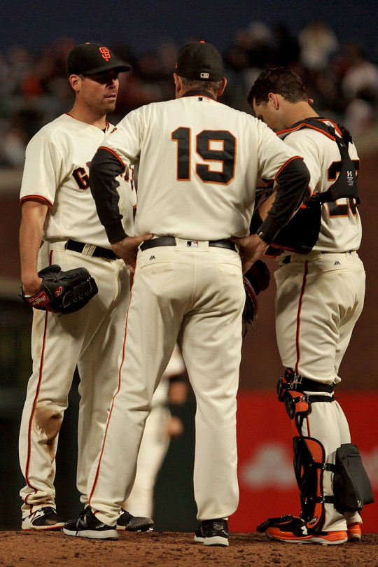 San Francisco Giants pitching coach Dave Righetti (19) talks with pitcher Matt Moore (45) and catcher Buster Posey (28) in the sixth inning as the Cleveland Indians face the San Francisco Giants at AT&T Park in San Francisco, Calif., on Monday, July 17, 2017.