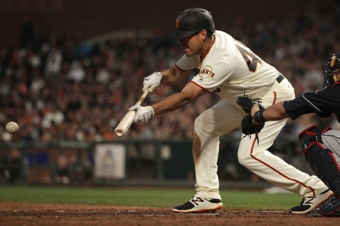 San Francisco Giants pitcher Matt Moore (45) bunts into a double play in the fifth inning as the Cleveland Indians face the San Francisco Giants at AT&T Park in San Francisco, Calif., on Monday, July 17, 2017.