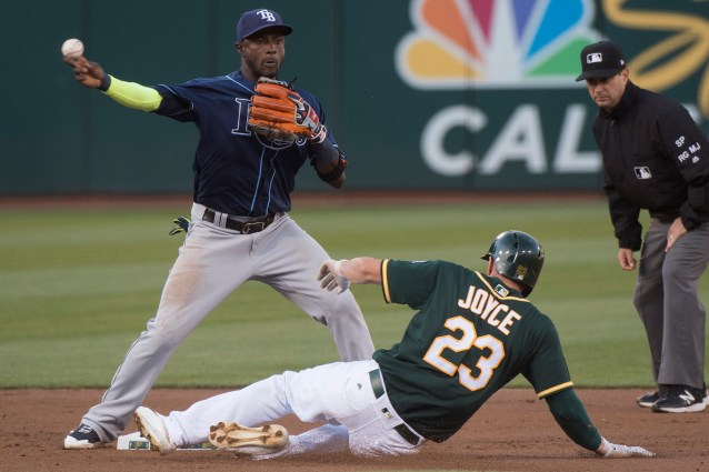 Tampa Bay Rays shortstop Adeiny Hechavarria (11) forces Oakland Athletics right fielder Matt Joyce (23) out at second in the first inning as the Oakland Athletics take on the Tampa Bay Rays at the Oakland Coliseum in Oakland, Calif., on July 17, 2017.