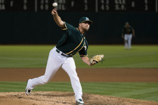 Oakland Athletics pitcher Blake Treinen (39) pitches in the eighth inning of the game against the Tampa Bay Rays at the Oakland Coliseum in Oakland, Calif., on July 17, 2017.