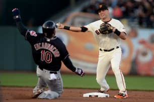 San Francisco Giants second baseman Joe Panik (12) forces out Cleveland Indians first baseman Edwin Encarnacion (10) as the Cleveland Indians face the San Francisco Giants at AT&T Park in San Francisco, Calif., on Tuesday, July 18, 2017.