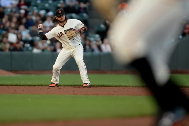 San Francisco Giants shortstop Brandon Crawford (35) begins a double play hit by Cleveland Indians catcher Yan Gomez (7) in the second inning as the Cleveland Indians face the San Francisco Giants at AT&T Park in San Francisco, Calif., on Tuesday, July 18, 2017.