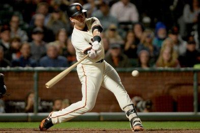 San Francisco Giants catcher Buster Posey (28) connects for an RBI single in the sixth inning as the Cleveland Indians face the San Francisco Giants at AT&T Park in San Francisco, Calif., on Tuesday, July 18, 2017.