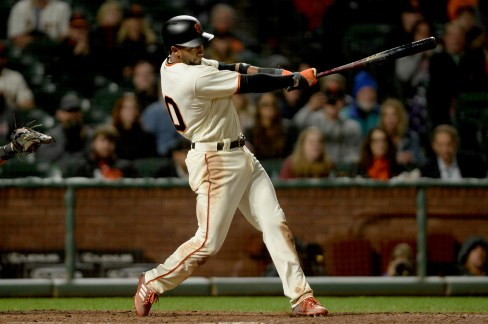 San Francisco Giants third baseman Eduardo Nunez (10) singles in the tenth as the San Francisco Giants beat the Cleveland Indians 2-1 at AT&T Park in San Francisco, Calif., on Tuesday, July 18, 2017.