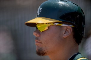 Oakland Athletics catcher Bruce Maxwell (13) waits on deck in the fourth inning as the Tampa Bay Rays face the Oakland Athletics at Oakland Coliseum in Oakland, Calif., on Wednesday, July 19, 2017.