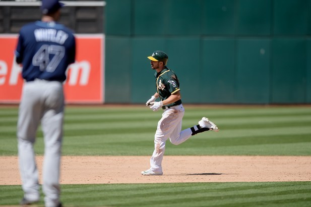 Oakland Athletics right fielder Matt Joyce (23) connects for a home run in the eighth inning as the Tampa Bay Rays face the Oakland Athletics at Oakland Coliseum in Oakland, Calif., on Wednesday, July 19, 2017.