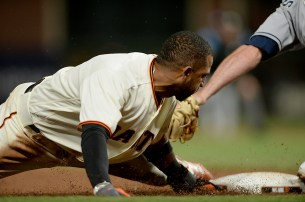 San Francisco Giants third baseman Eduardo Nunez (10) is caught stealing at third base in the sixth inning as the San Diego Padres face the San Francisco Giants at AT&T Park in San Francisco, Calif., on Thursday, July 20, 2017.