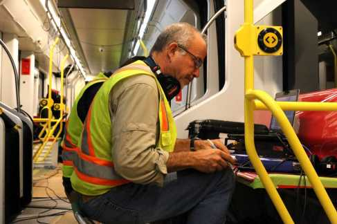 Mike Amato, senior consultant and lab manager at Wilson Ihrig, records and compares noise and vibrations from the Muni's new train and compares it to Muni's beta trains in San Francisco, Calif., on Friday, July 21, 2017.