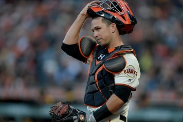 San Francisco Giants catcher Buster Posey (28) looks for a sign in the second inning as the Pittsburgh Pirates face the San Francisco Giants at AT&T Park in San Francisco, Calif., on Monday, July 24, 2017.