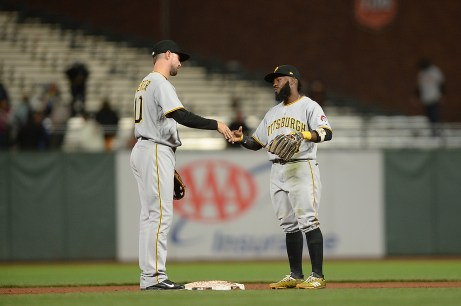 Pittsburgh Pirates second baseman Josh Harrison (5) and shortstop Jordy Mercer (10) congratulate each other after the 10-3 win over the San Francisco Giants at AT&T Park in San Francisco, Calif., on Monday, July 24, 2017.