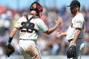 San Francisco Giants catcher Buster Posey (28) congratulates San Francisco Giants relied pitcher Sam Dyson (49) after closing out a 2-1 victory over the Pittsburgh Pirates at AT&T Park in San Francisco, Calif., on Wednesday, July 26, 2017.