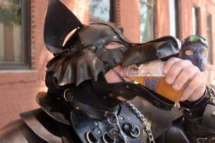 "Bryan ""Smash"" Manteranch, 45, an IT professional from Santa Cruz, Calif., drinks beer through his pup mask at the Up Your Alley fair in the South of Market district of San Francisco, Calif., on Sunday, July 30, 2017. The mask is representative of the pup culture, a sub-group of the leather community."