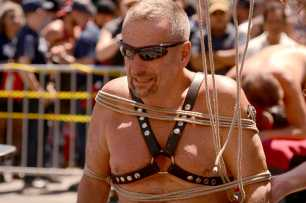 Ken Briggs, 75, a retiree from Marin County, Calif., is untied from bondage at the Up Your Alley fair in the South of Market district of San Francisco, Calif., on Sunday, July 30, 2017.
