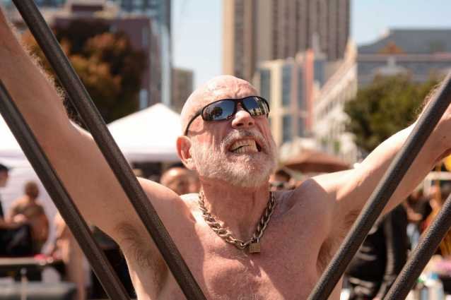 Matt Stroud, 66, a retiree from Palm Springs, Calif., cries out as he reacts to being flogged at the Up Your Alley fair in the South of Market district of San Francisco, Calif., on Sunday, July 30, 2017.