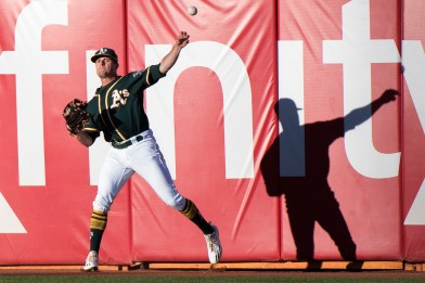 Oakland Athletics center fielder Jaycob Brugman (38) throws the ball back to the infield in the first inning of the game against the San Francisco Giants at the Oakland Coliseum in Oakland, Calif., on July 31, 2017.