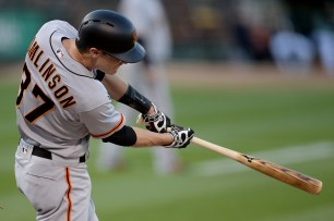 San Francisco Giants second baseman Kelby Tomlinson (37) connects for an RBI single in the first inning as the San Francisco Giants face the Oakland Athletics at Oakland Coliseum in Oakland, Calif., on Tuesday, August 1, 2017.