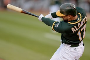 Oakland Athletics first baseman Yonder Alonso (17) connects for an RBI single in the first inning as the San Francisco Giants face the Oakland Athletics at Oakland Coliseum in Oakland, Calif., on Tuesday, August 1, 2017.