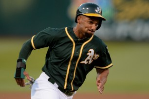 Oakland Athletics shortstop Marcus Semien (10) scores in the first inning as the San Francisco Giants face the Oakland Athletics at Oakland Coliseum in Oakland, Calif., on Tuesday, August 1, 2017.