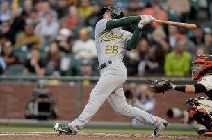 Oakland Athletics third baseman Matt Chapman (26) doubles in the second inning as the Oakland Athletics face the San Francisco Giants at AT&T Park in San Francisco, Calif., on Tuesday, August 2, 2017.